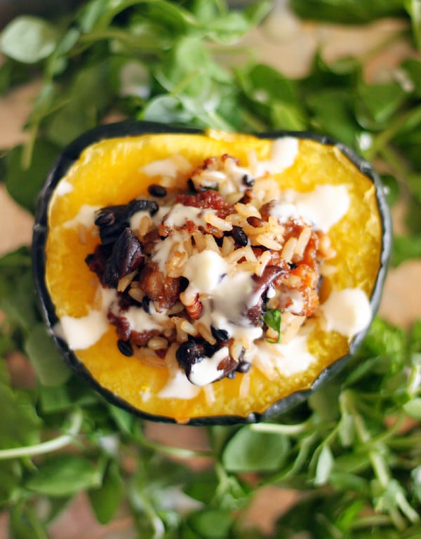 Sausage and Rice Stuffed Acorn Squash with Lemon Drizzle