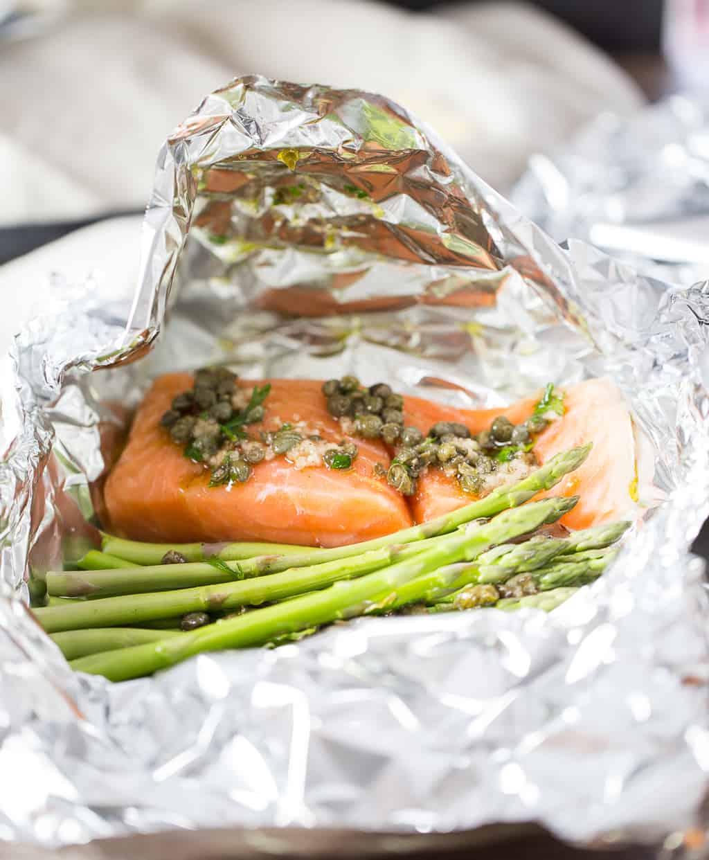salmon foil packets with vegetables about to go into the oven