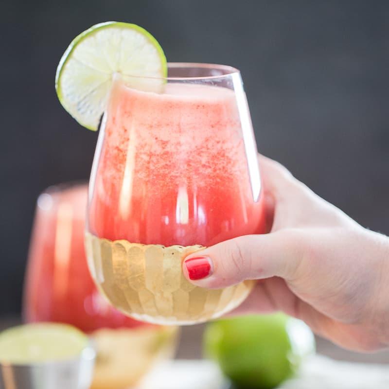 tequila watermelon aqua fresca in hand