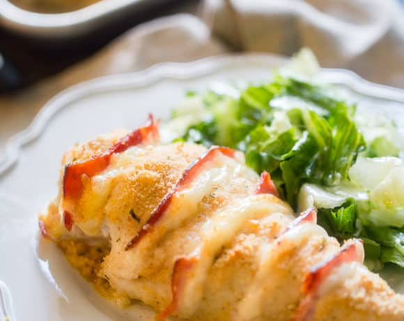 Baked Chicken Cordon Bleu featured image of chicken on plate with a salad