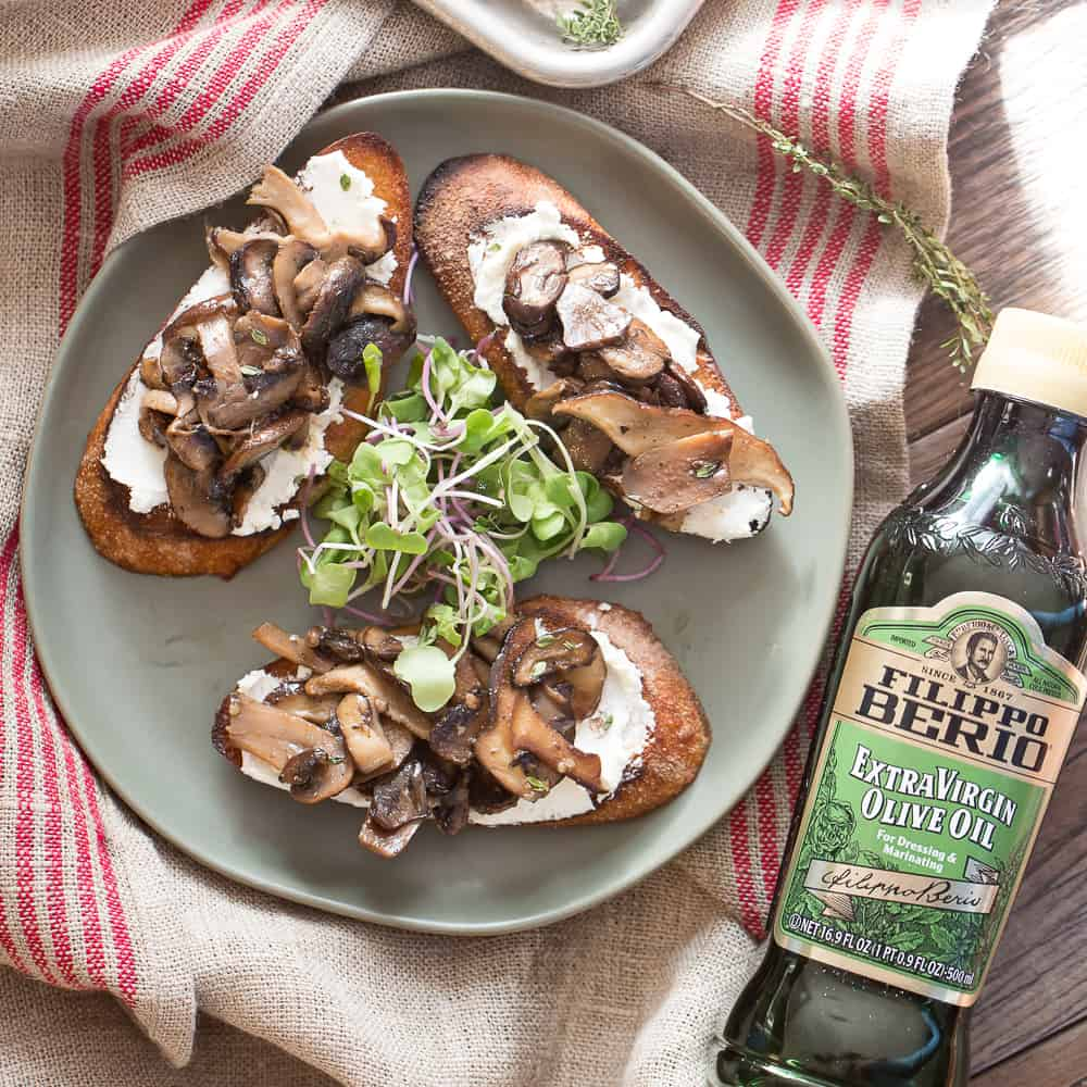 Overhead shot of mushroom toasts with goat cheese
