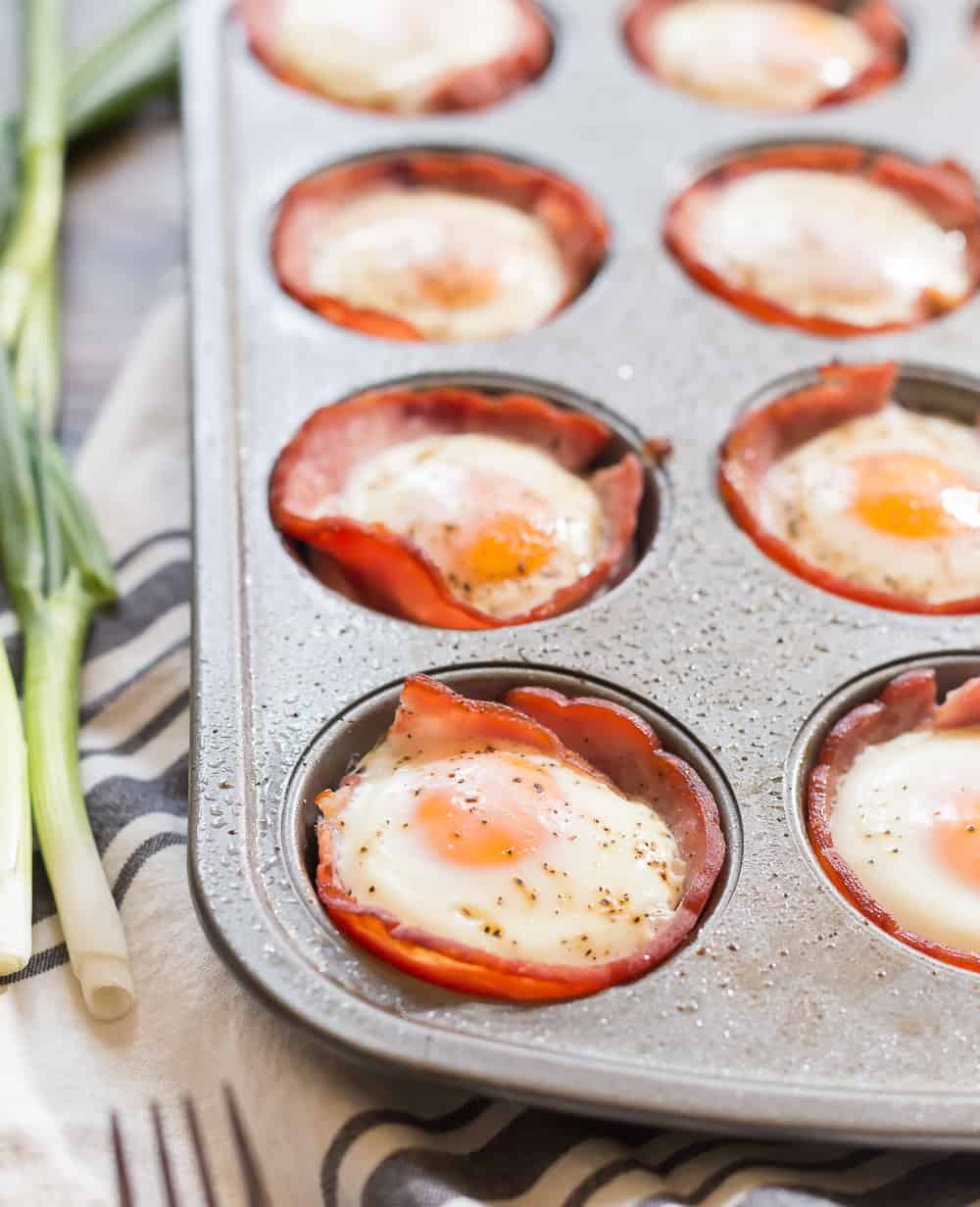 Cooked eggs in ham in a muffin pan