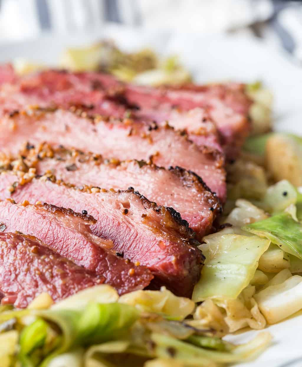 baked corned beef on top of cabbage