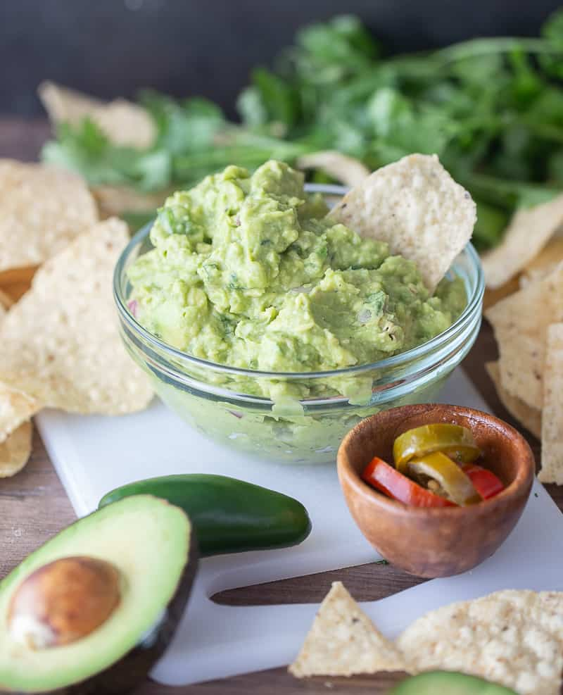 the best guacamole recipe - guacamole with a chip in the bowl