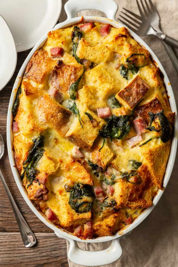 baked strata from overhead with spinach, ham, and gruyere cheese