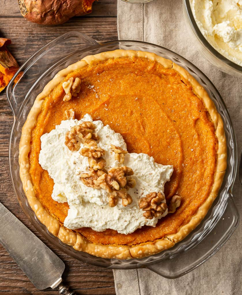 sweet potato pie with bourbon whipped cream and walnuts