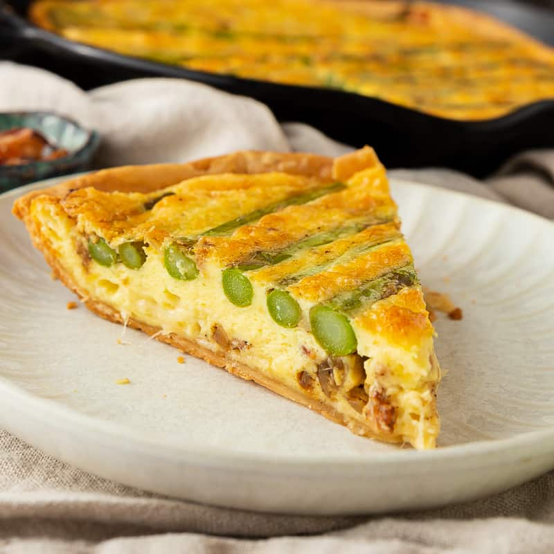 crossection of asparagus quiche with gruyere and bacon