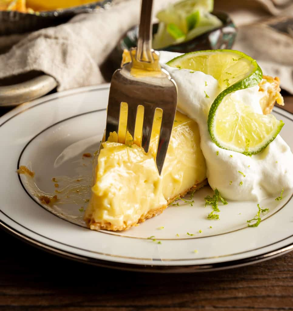 piece of key lime pie with fork in it